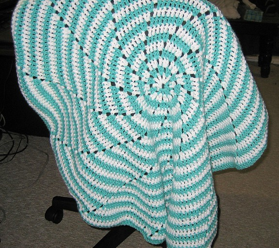 Spiral Baby Blanket Draped On a Chair